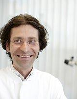 Dr. med. dent. Tomas Lang